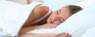 Women asleep after curing insomnia