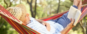 Man relaxed in a hammock to reduce stress