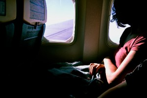 Fear of Flying Hypnotherapy, lady looking out a plane window