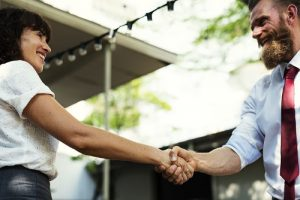 Increasing Assertiveness Hypnotherapy, man & woman shaking hands in agreement